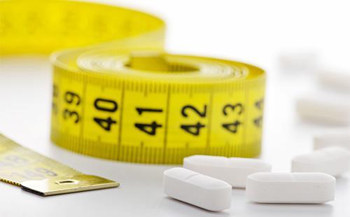 Таблетки и белый сантиметр
